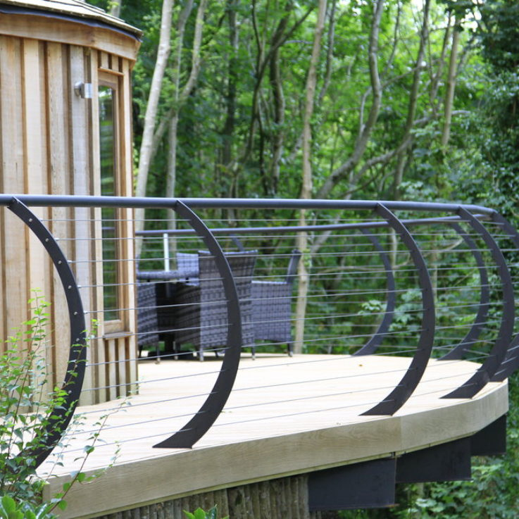 Bespoke curved metal balcony with Dart Fabrication