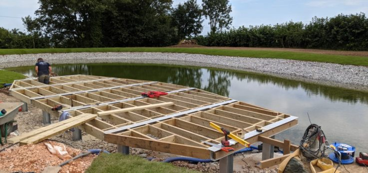 Lake with jetty in construction